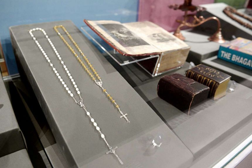 Christian artifacts at the exhibit include Rosary beads and a Bible.