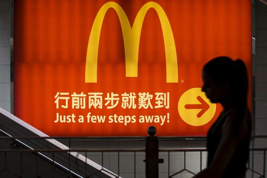 Carlyle Group and TPG Capital have teamed up with two separate Chinese state companies to bid for McDonald's outlets in China and Hong Kong.