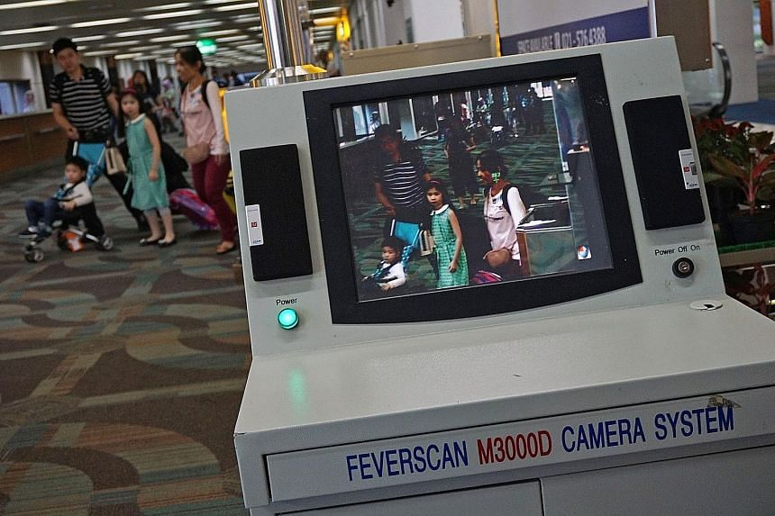 A scanner being used to detect people with fever at Soekarno Hatta International Airport in Tangerang, on the outskirts of Jakarta, yesterday. Fever is one of the symptoms of Zika infection. Other symptoms include an itchy rash, body aches and red ey