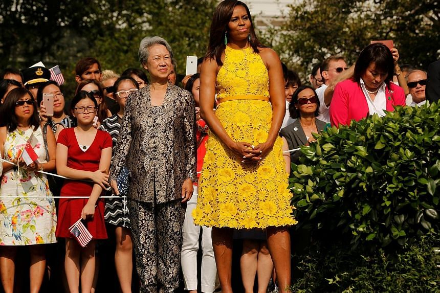 Naeem Khan's yellow dress worn by United States First Lady Michelle Obama (left, seen with Mrs Lee Hsien Loong) and looks from the designer's Resort 2017 collection (above).