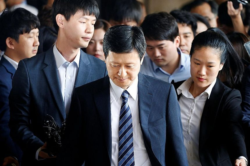 Lotte Group founder Shin Kyuk Ho's elder son Shin Dong Joo (centre) is in a bitter fight with his younger brother to wrest control of the family-run conglomerate, which spans 93 companies.