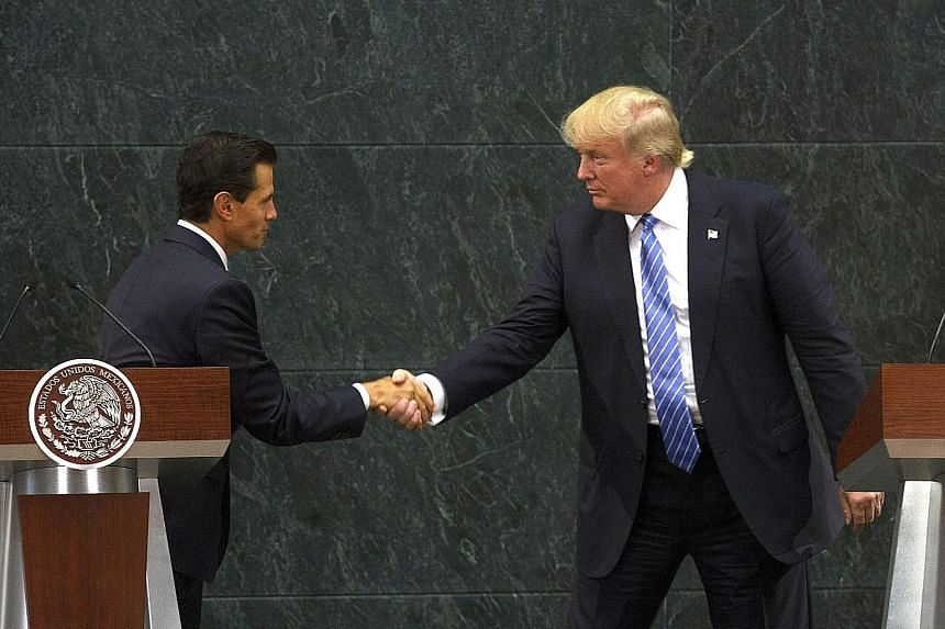 Fresh from a controversial visit to Mexico - where he met Mexican President Enrique Pena Nieto (far left) and where the wall was an especially contentious issue - Republican candidate Donald Trump pointedly made it the first issue in his 10-point pla
