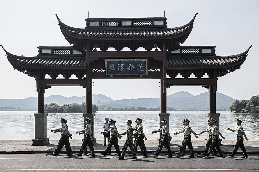 Paramilitary police officers marching by West Lake in Hangzhou on Monday. China's leading role at this weekend's summit will be a marked change from its outsider role at the first G-20 summit in 2008.