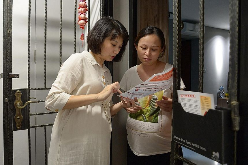 Ms Sun (left), who is seven months pregnant, speaking with Punggol Way resident Soo Ee, who is due to give birth in two weeks. Ms Sun is stepping up efforts to raise awareness of Zika prevention after a Punggol Way resident was diagnosed with the vir
