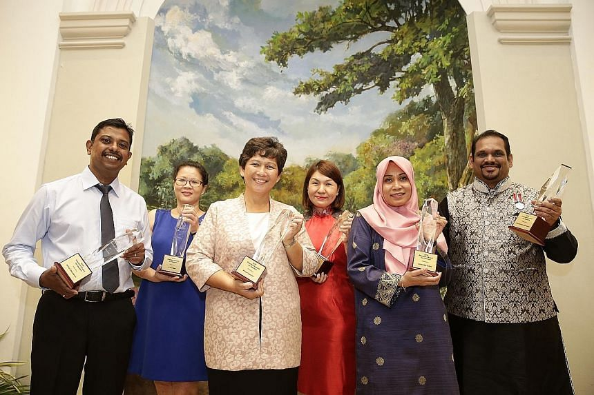 For their outstanding teaching and dedication to their students, six teachers received the President's Award for Teachers (PAT) from President Tony Tan Keng Yam at the Istana yesterday. They are (from far left): Mr Anil Vasudevan of Marsiling Seconda