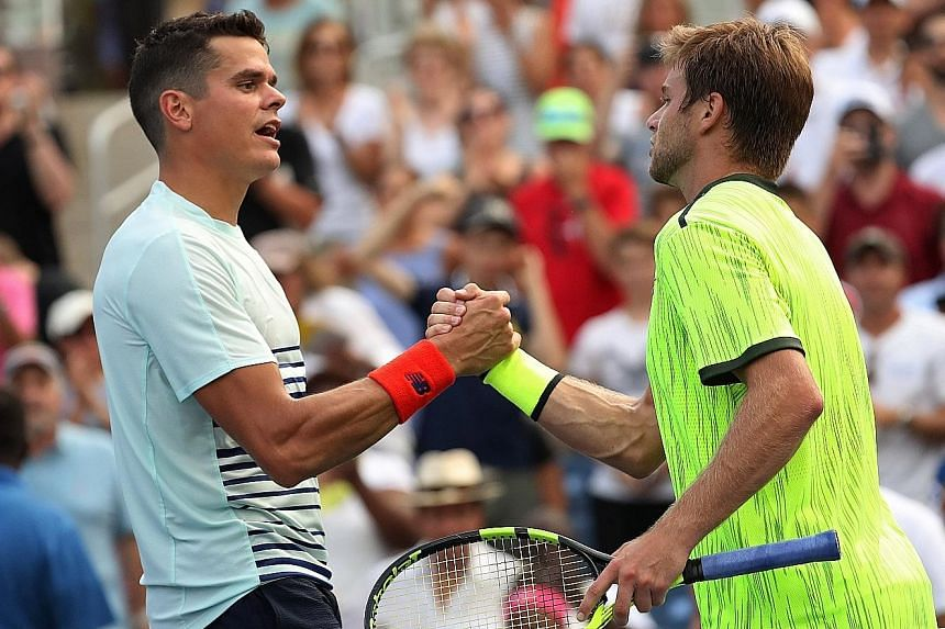 World No. 5 Milos Raonic (left) of Canada congratulates Ryan Harrison after their US Open second round match. The American qualifier has reached the third round of a Major for the first time in 20 appearances.