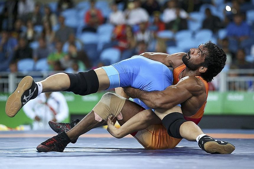 Yogeshwar Dutt (in orange) competing in last month's Rio Olympics. The wrestler declined to upgrade his 2012 bronze to silver, as the original silver medallist has died from a car crash.