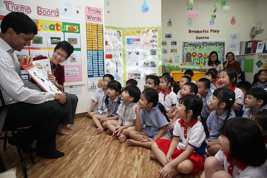 Ms Fu and Mr Vikram Nair, MP for Sembawang GRC, reading the book to pre-schoolers at PCF Sparkletots Admiralty Childcare. The book, written by Touch Community Services, will be distributed to 50,000 pre-schoolers.
