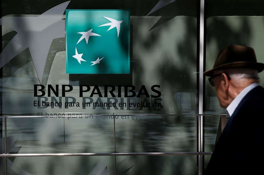 A man walks past a BNP Paribas bank office in Madrid, Spain on June 7, 2016.