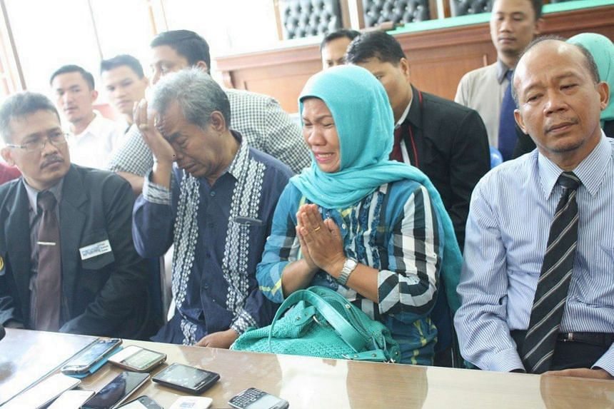 Parents of Medan church attack suspect, Makmur Hasugian, 65, (second from left), and Arista Purba, 54, (third from left)  apologise to Christians during a press conference in Medan on Sept 1.