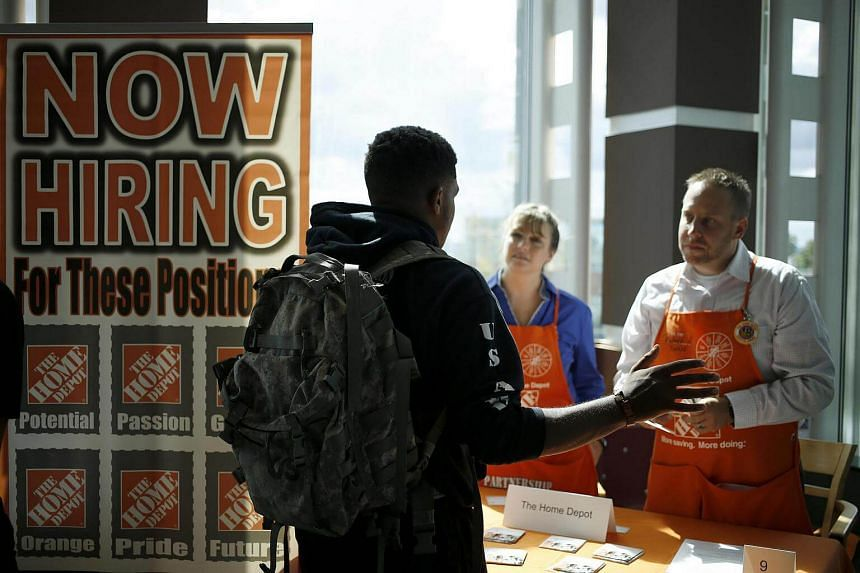 A job seeker speaks with recruiters from The Home Depot at a Recruit Military veterans job fair in Cleveland, Ohio, US, on Sept 1, 2016.