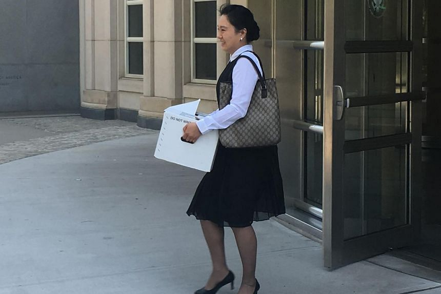 Former Air China employee Ying Lin exits the building after a pretrial hearing in federal court in Brooklyn, New York on June 21, 2016.