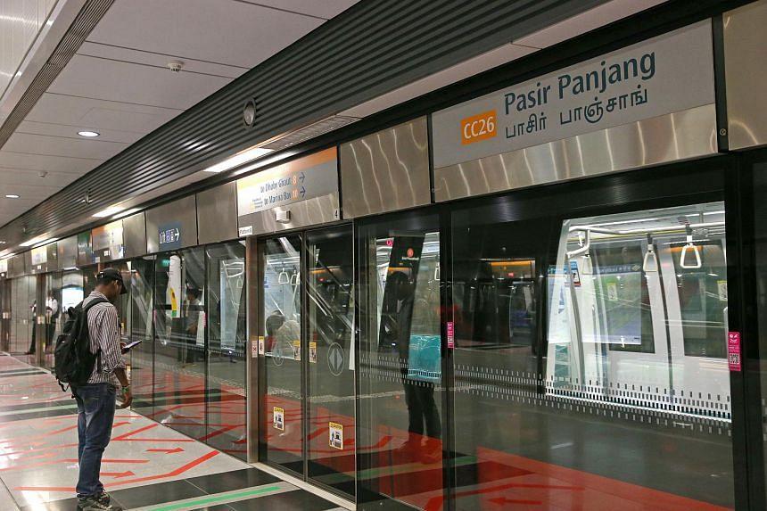 A commuter using his mobile phone at Pasir Panjang MRT station on Sept 2, 2016.
