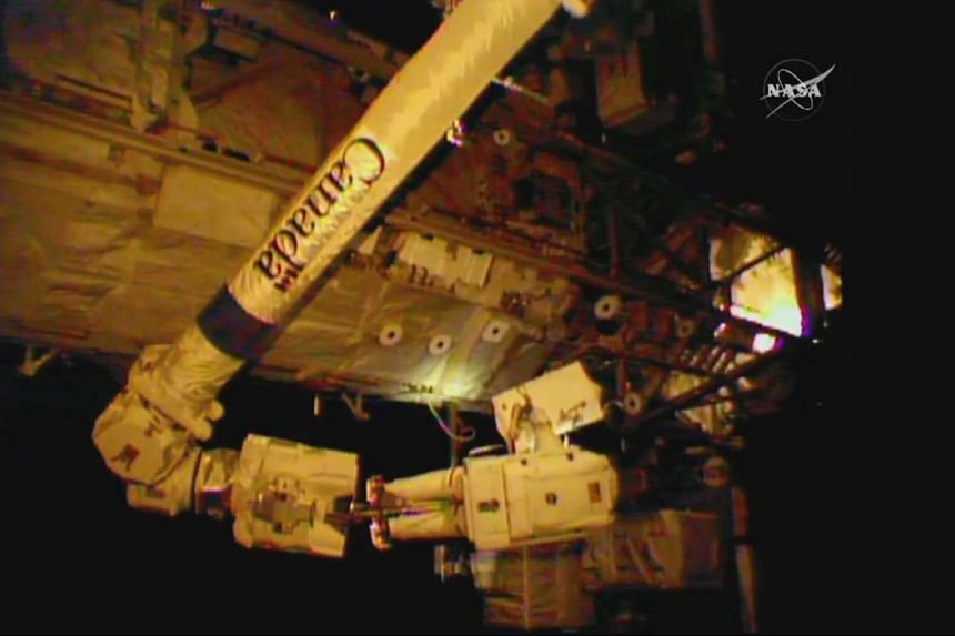 A Nasa TV video grab shows astronaut Jeff Williams making repairs and installing new equipment.