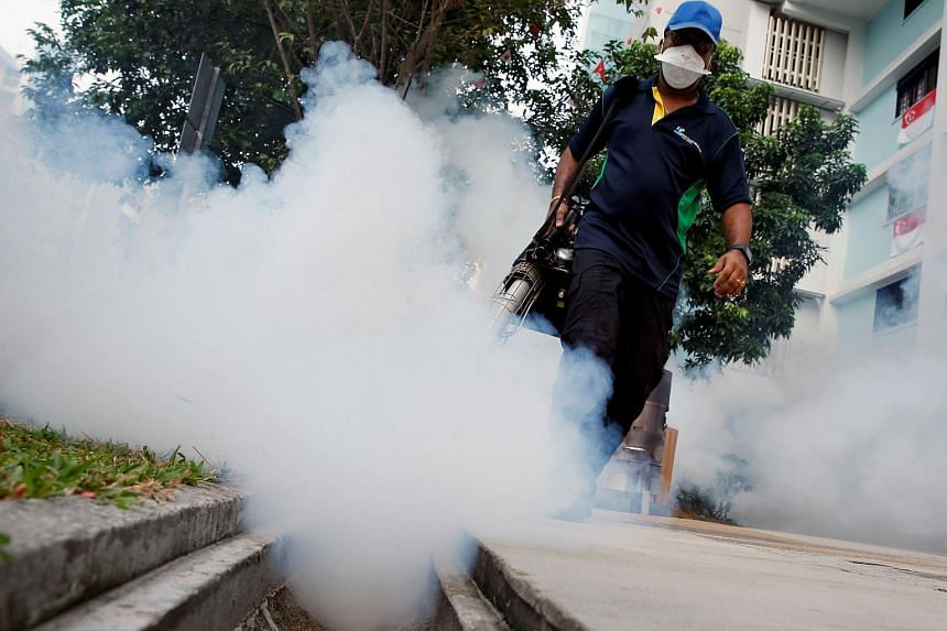 A worker fogs the common area of a public housing estate at a new Zika cluster in Singapore on Sept 1, 2016.