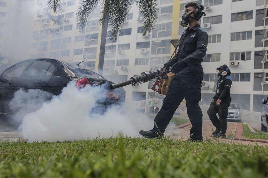 Pest exterminators fumigating a carpark in Aljunied, on Aug 31.