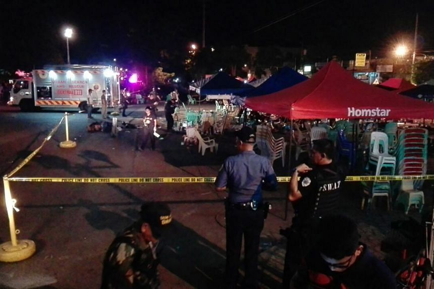 Police gather evidence at the scene of the blast in Davao city, the Philippines, Sept 2, 2016.