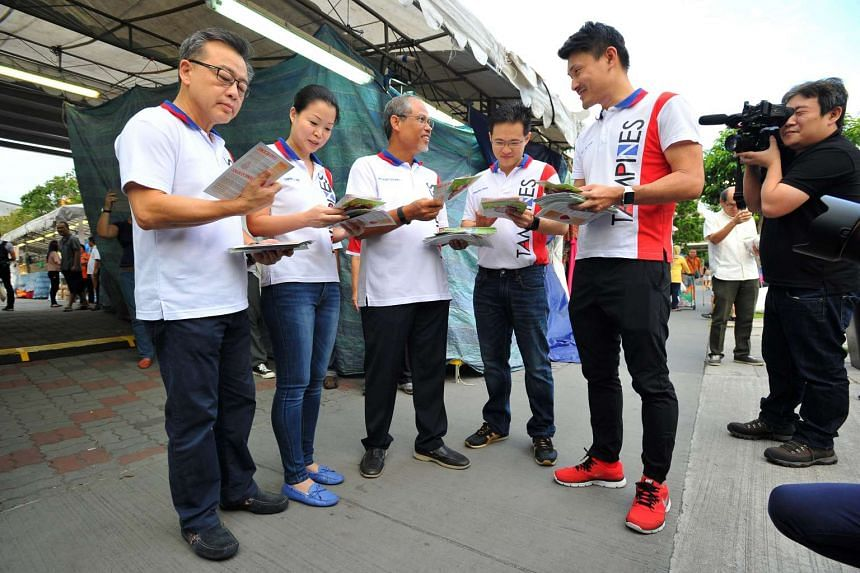 (From left) Former Tampines Central Member of Parliament (MP) Sin Boon Ann, together with Tampines GRC MPs Miss Cheng Li Hui, Mr Masagos Zulkifli Bin Masagos Mohamad, Mr Desmond Choo, Mr Baey Yam Keng, doing outreach on Zika at Tampines Ave 3 on Sept