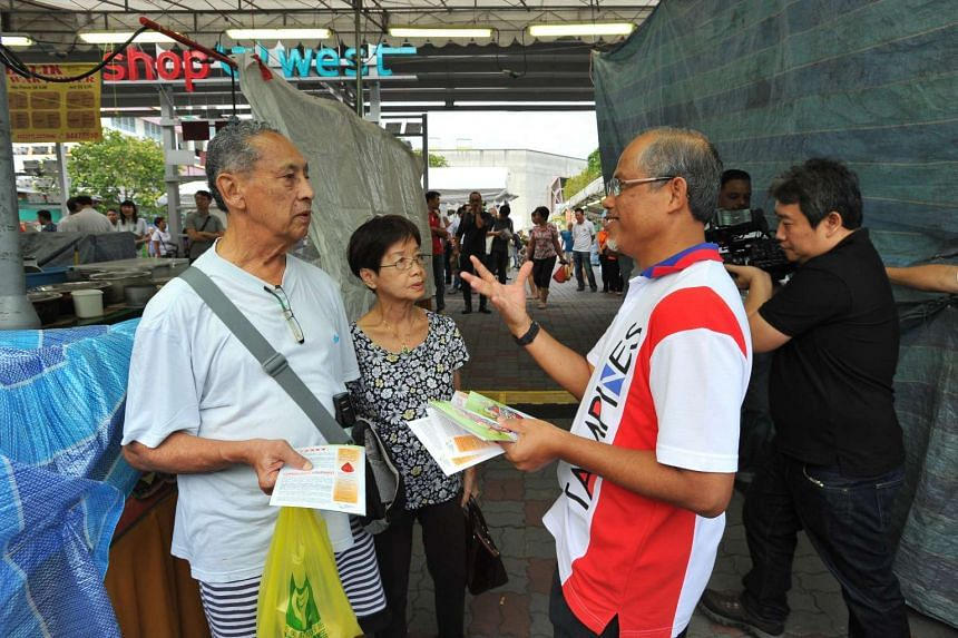 Minister for the Environment and Water Resources Masagos Zulkifli (right) speaking with Mr Horace Pinto (left) 82, and Madam Lucy Tan (centre) 79, on Zika and mosquito prevention at Tampines Ave 3 on Sept 3.