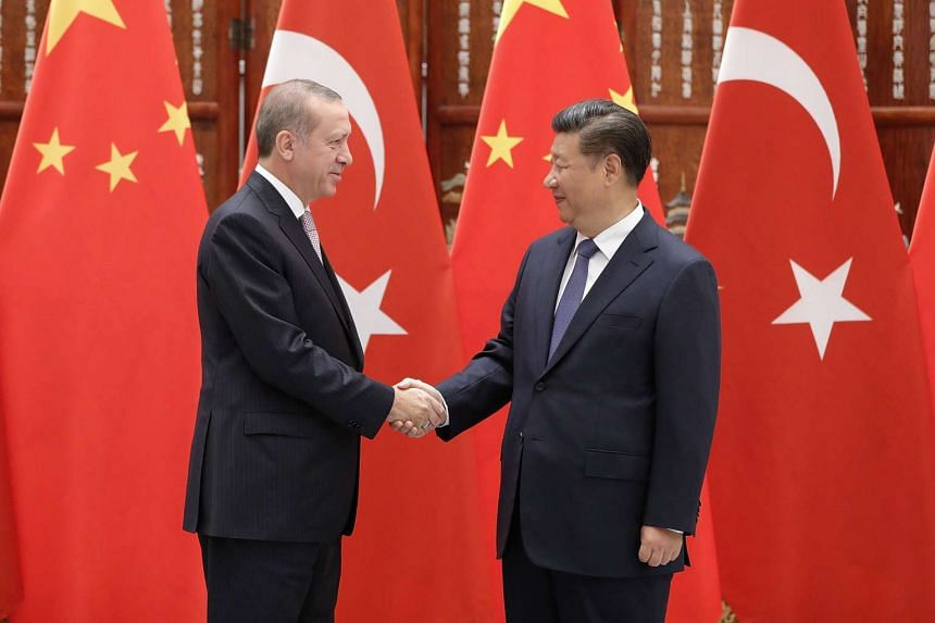 Chinese President Xi Jinping (right) shaking hands with Turkish President Recep Tayyip Erdogan before their meeting at the West Lake State Guest House on Sept 3, 2016, in Hangzhou, China.