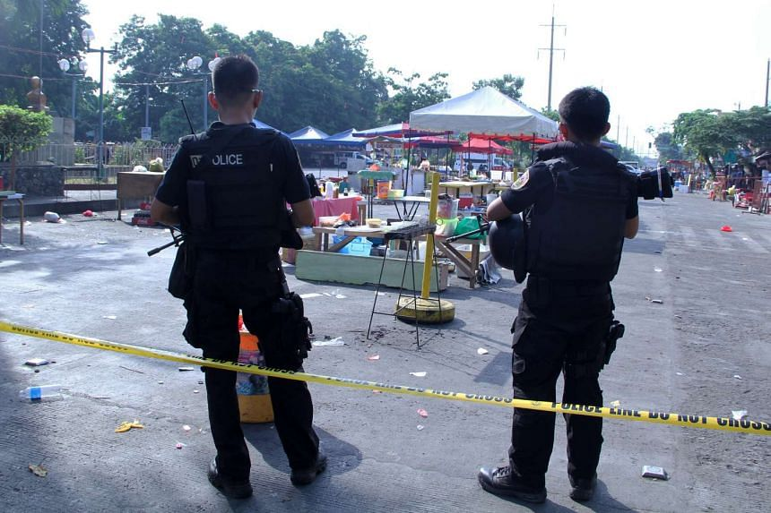 Filipino SWAT officers standing guard at the site of an explosion at a night market in Davao city, Philippines, on Sept 3, 2016.
