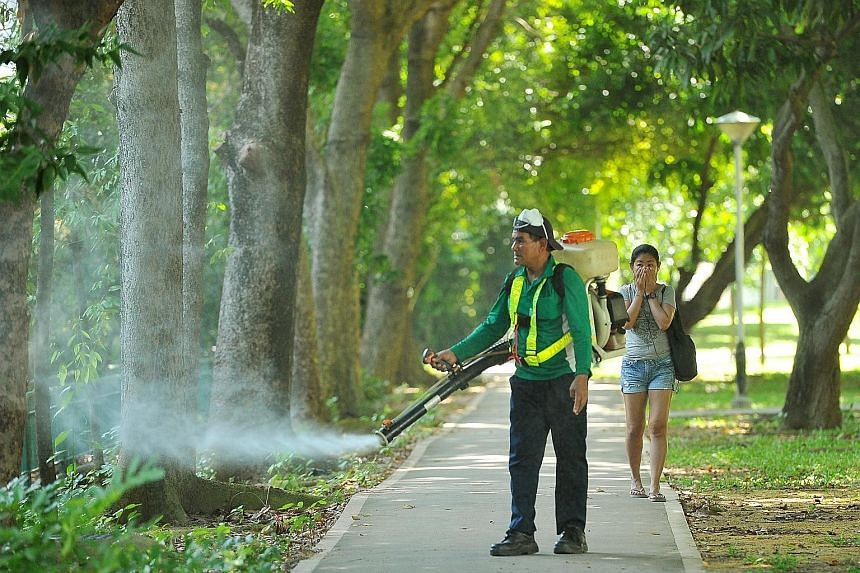 Misting being carried out yesterday near Block 101, Aljunied Crescent. Those living in the Zika cluster say they are not overly worried and take the necessary precautions.