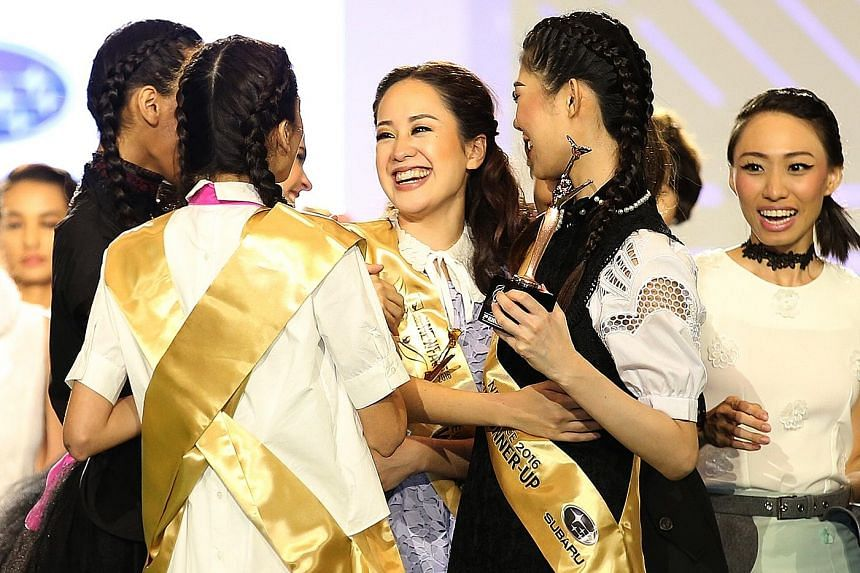 Miss Kim Min Pei Lam (centre) receiving congratulatory hugs from fellow contestants of The New Paper New Face 2016. She won a $10,000 cash prize, along with an exclusive feature in Her World magazine.