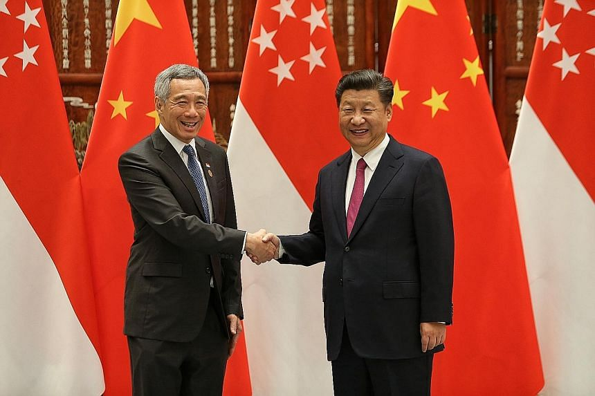 PM Lee and Mr Xi meeting for bilateral talks in Hangzhou yesterday. They exchanged views on Singapore's role as Asean-China dialogue relations coordinator. Mr Lee is on a four-day working visit to China.