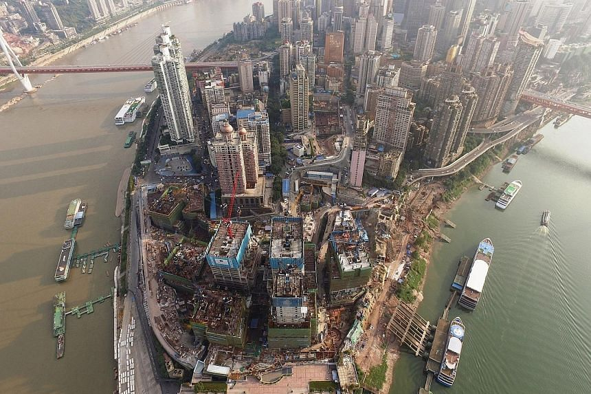 The Raffles City Chongqing site last month. The project by CapitaLand is the largest single investment by a Singapore company in China.