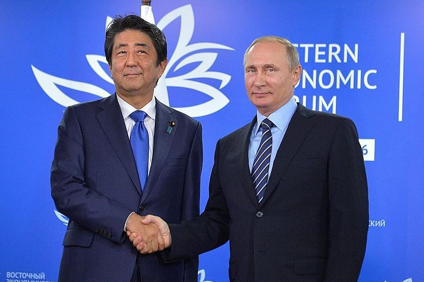Before meeting Mr Abe (far left) on the sidelines of the Eastern Economic Forum, Mr Putin had reportedly said he would not contemplate giving up territory to Tokyo.