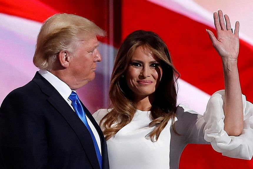 Mrs Trump with her husband at the Republican National Convention in July. She is suing Mail Media, publisher of Daily Mail Online, and Mr Webster Tarpley, who publishes a blog.