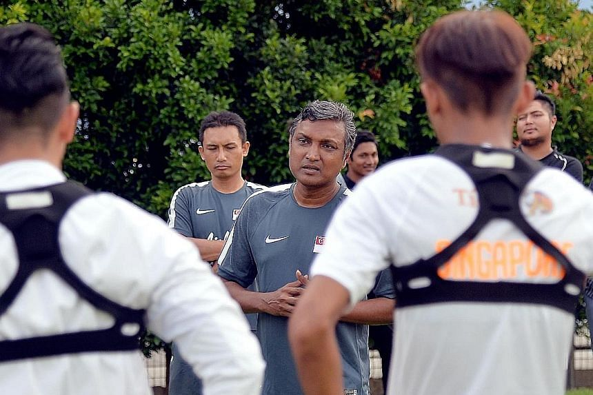 National caretaker football coach V. Sundramoorthy talking to his players during a training session. Singapore are drawn in Group A in the AFF Suzuki Cup in November with Thailand, the Philippines and Indonesia.