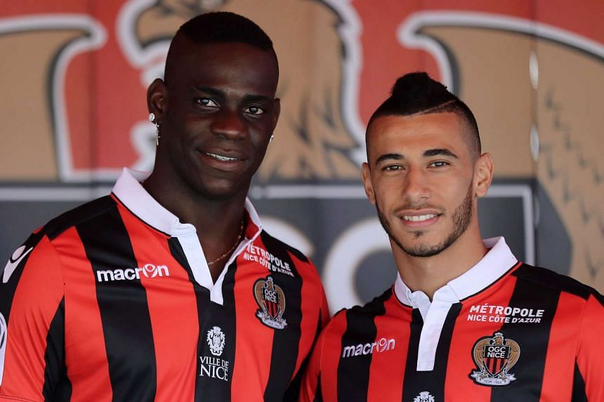 Nice's new signings, Balotelli (left) and French-born Moroccan midfielder Younes Belhanda, pose on Sept 2, 2016.