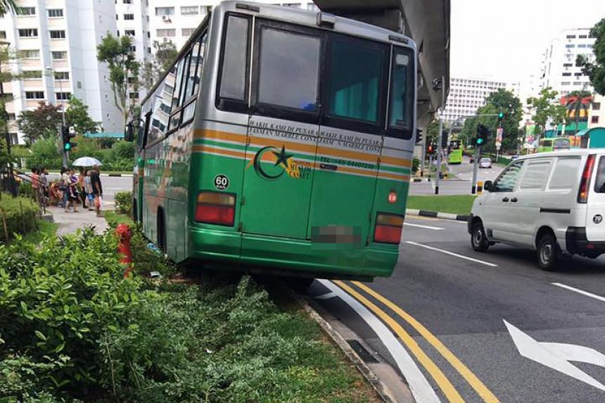 A private bus rolled down a slope in Bukit Panjang, knocking down a road sign and causing the death of a 68-year-old woman on Sept 2, 2016.