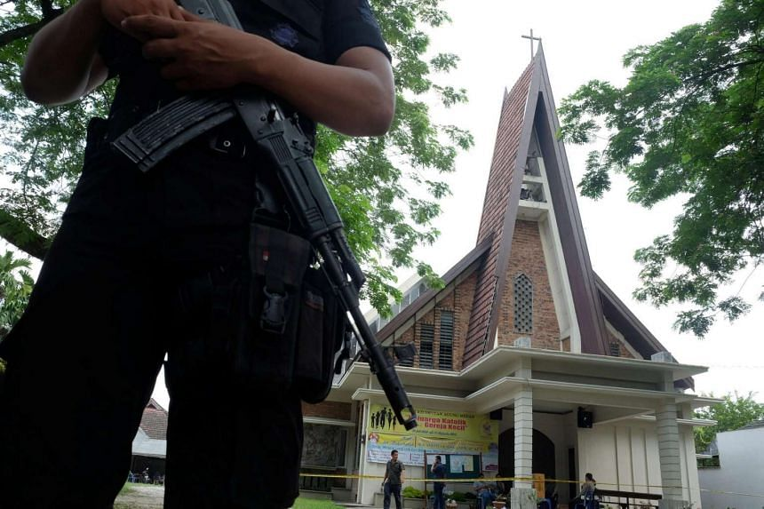 Policemen are seen outside Saint Joseph's Catholic Church after a suspected terror attack on a priest during Sunday service in Medan, Indonesia, on Aug 28, 2016, in this photo taken by Antara Foto.