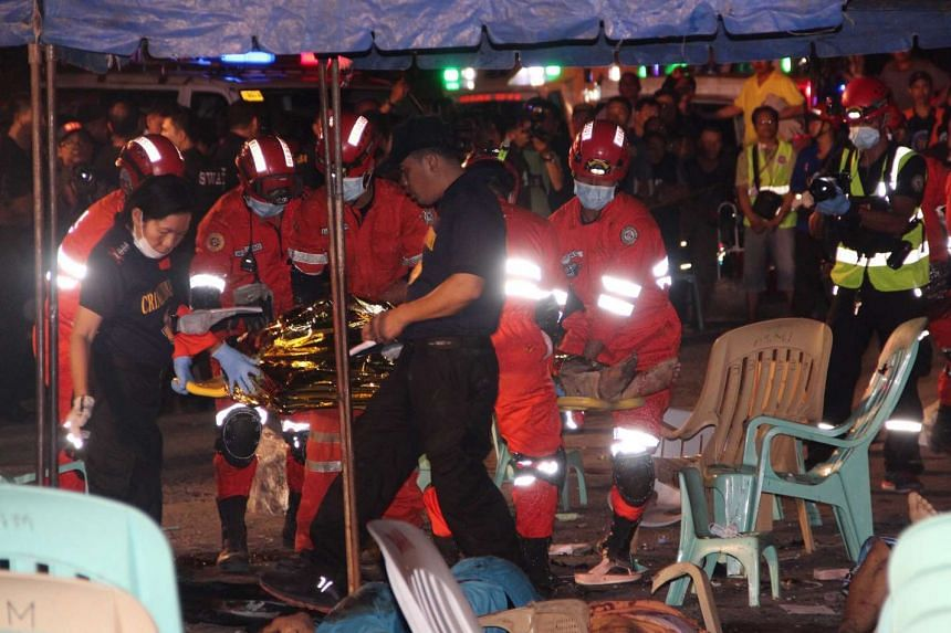 Rescuers carry a victim at the site of the explosion.