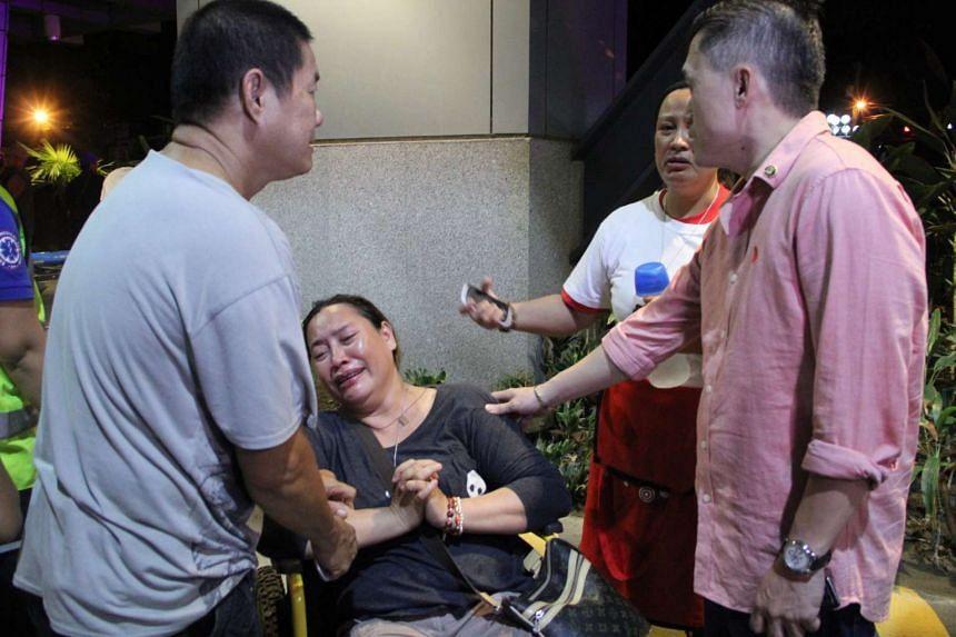 A Filipino relative cries near the site of the blast.