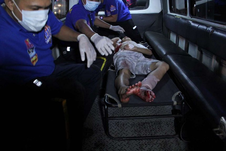 Rescuers load a victim into an ambulance at the site of the blast.