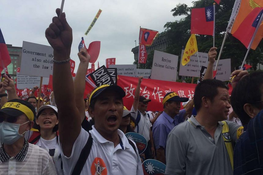 "Demonstrators on the streets of Taipei on Saturday (Sept 3, 2016) in protest against the government's pension reform plans, which they say are unfair and ""humiliate"" their professions."