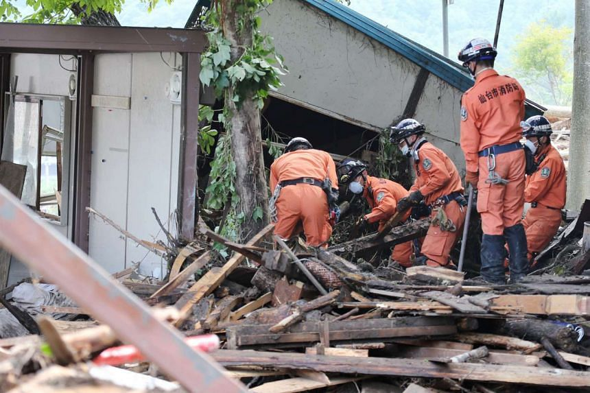 Firefighters search for missing victims after Typhoon Lionrock made landfall in Iwaizumi, Iwate prefecture on Sept 2, 2016.