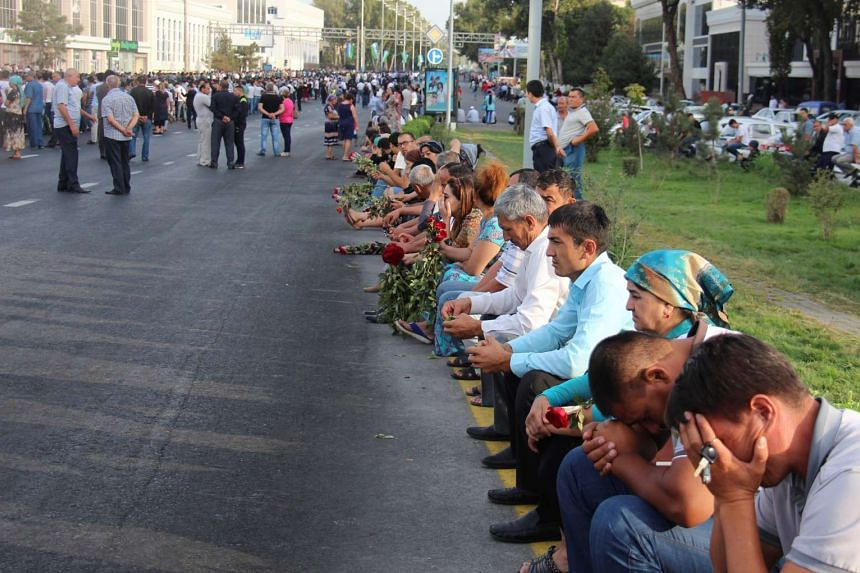People gather to pay their last respects during the funeral ceremony of President Islam Karimov on Sept 3, 2016.