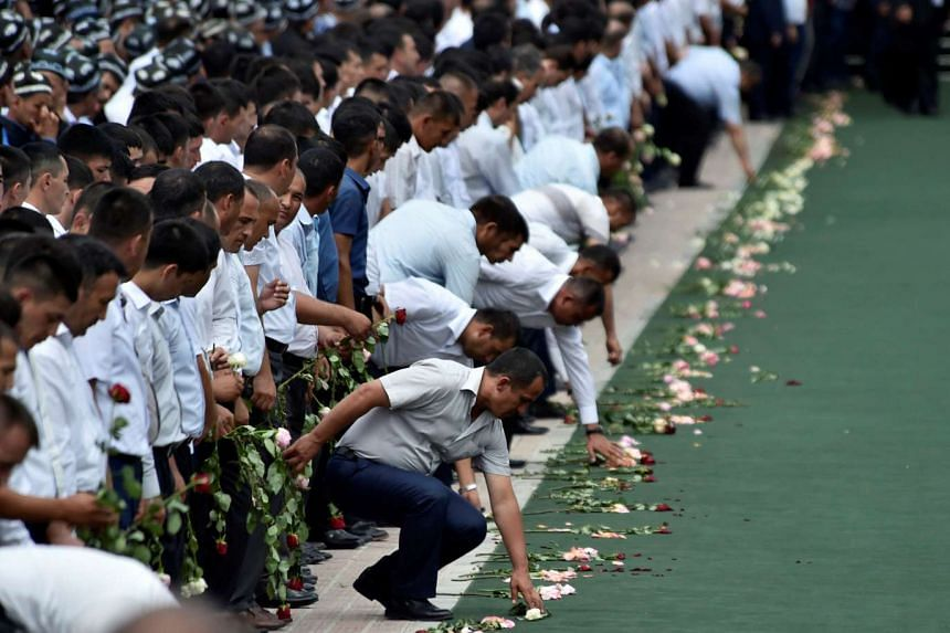Uzbek men gather to pay their last respects during the funeral ceremony of President Islam Karimov on Sept 3, 2016.