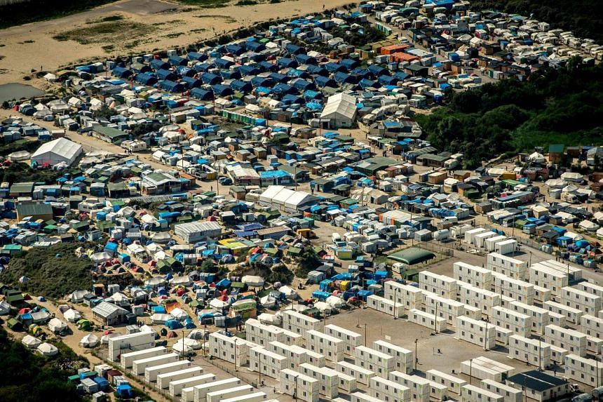 """A photo taken on Aug 16, 2016, shows an aerial view of tents in the """"Jungle"""" camp in Calais, northern France."""
