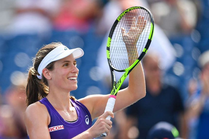 Johanna Konta of Great Britain celebrates her victory over Belinda Bencic of Switzerland.