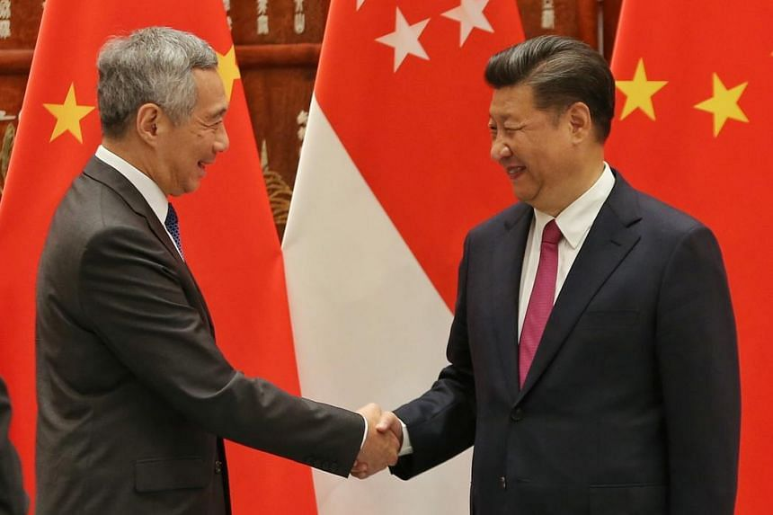 PM Lee Hsien Loong shaking hands with President Xi Jinping on Sept 2.