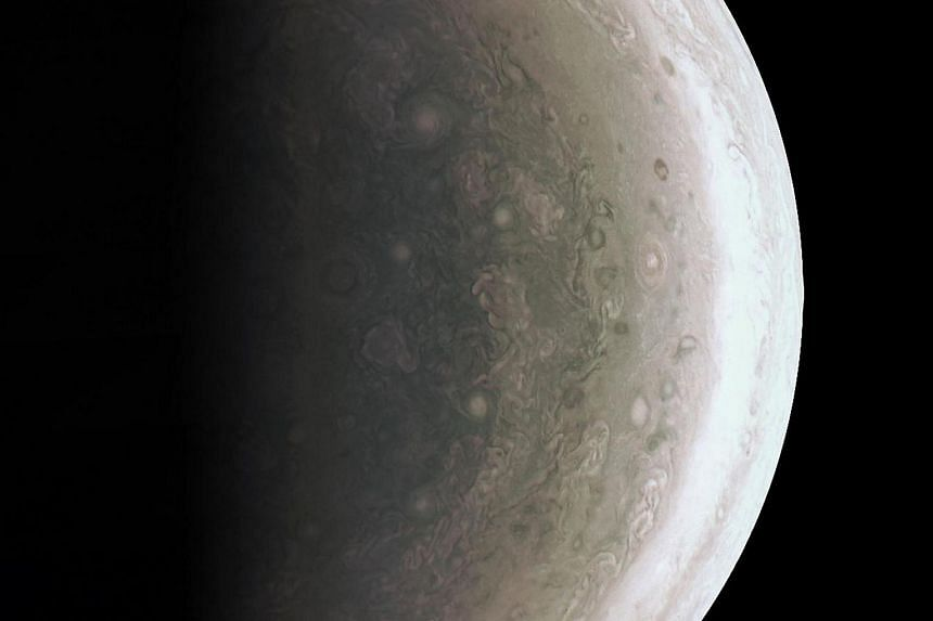 This image from Nasa's Juno spacecraft provides a never-before-seen perspective on Jupiter's south pole. The JunoCam instrument acquired the view on Aug 27, 2016, when the spacecraft was about 94,500km above the polar region.