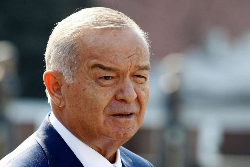 Uzbek President Islam Karimov leaving after a wreath laying ceremony at the Tomb of the Unknown Soldier near Moscow's Kremlin walls, on April 15, 2013.