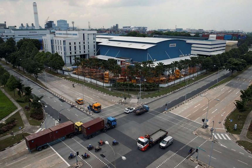 Factories in the Jurong industrial district. Last month's PMI reading of 49.8 was up slightly from July's, but economists warned against over-optimism.