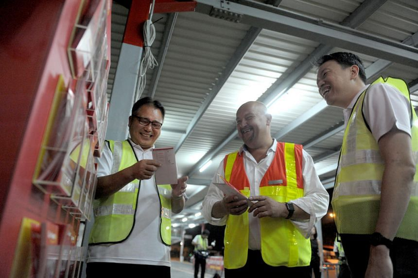 (From left) Mr Fang Chin Poh, General Secretary of National Transport Workers' Union (NTWU), Mr Nigel Wood, Managing Director of Go-Ahead Singapore, and Mr Melvin Yong, Excecutive Secretary of NTWU.
