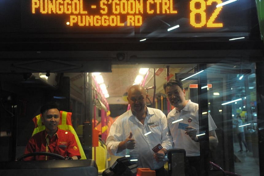 Mr Nigel Wood, Managing Director of Go-Ahead Singapore, and Mr Melvin Yong, Excecutive Secretary of NTWU in the first bus service of Go-Ahead Singapore.